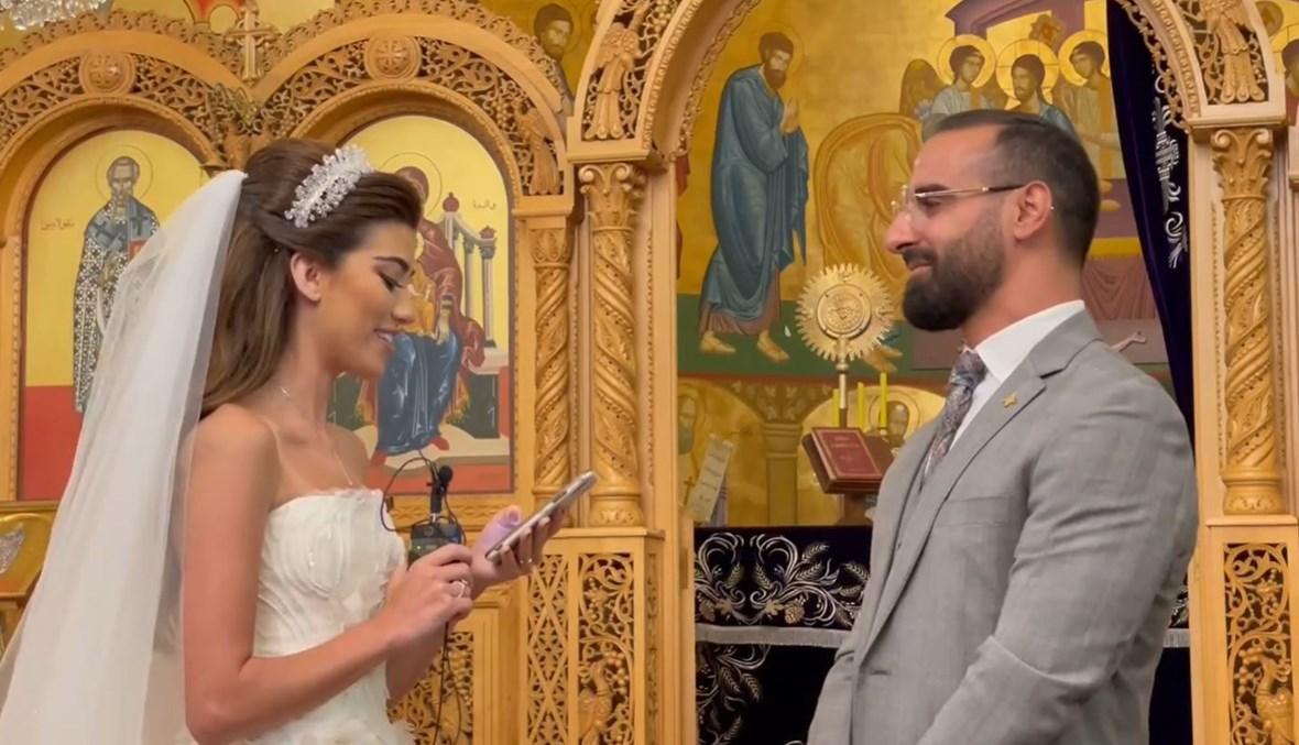 غريسيا أنطون في حفل زفافها مع زوجها جان مجاعص.