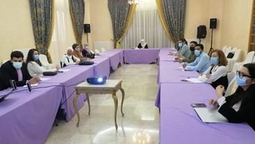 خلال الاجتماع في مجدليون.