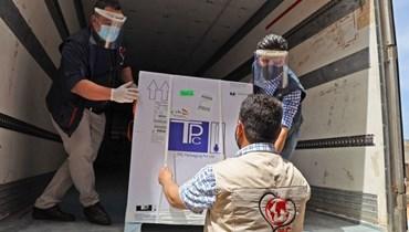 وصول أول دفعة لقاحات إلى سوريا (أ ف ب).