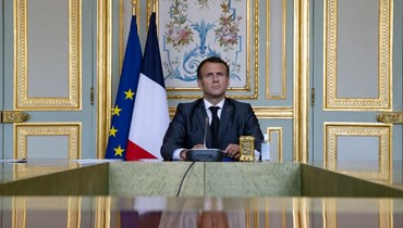 ماكرون يحضر قمة المناخ الافتراضية، عبر الفيديو، في قصر الإليزيه في باريس (22 نيسان 2021، أ ف ب).