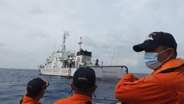عناصر من خفر السواحل الفيليبينيين خلال المناورات البحرية بالقرب من جزيرة ثيتو في بحر الصين الجنوبي (25 نيسان 2021، أ ف ب).