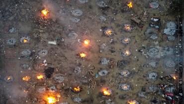 صور صادمة... طوابير من الجثث المحروقة لضحايا كورونا