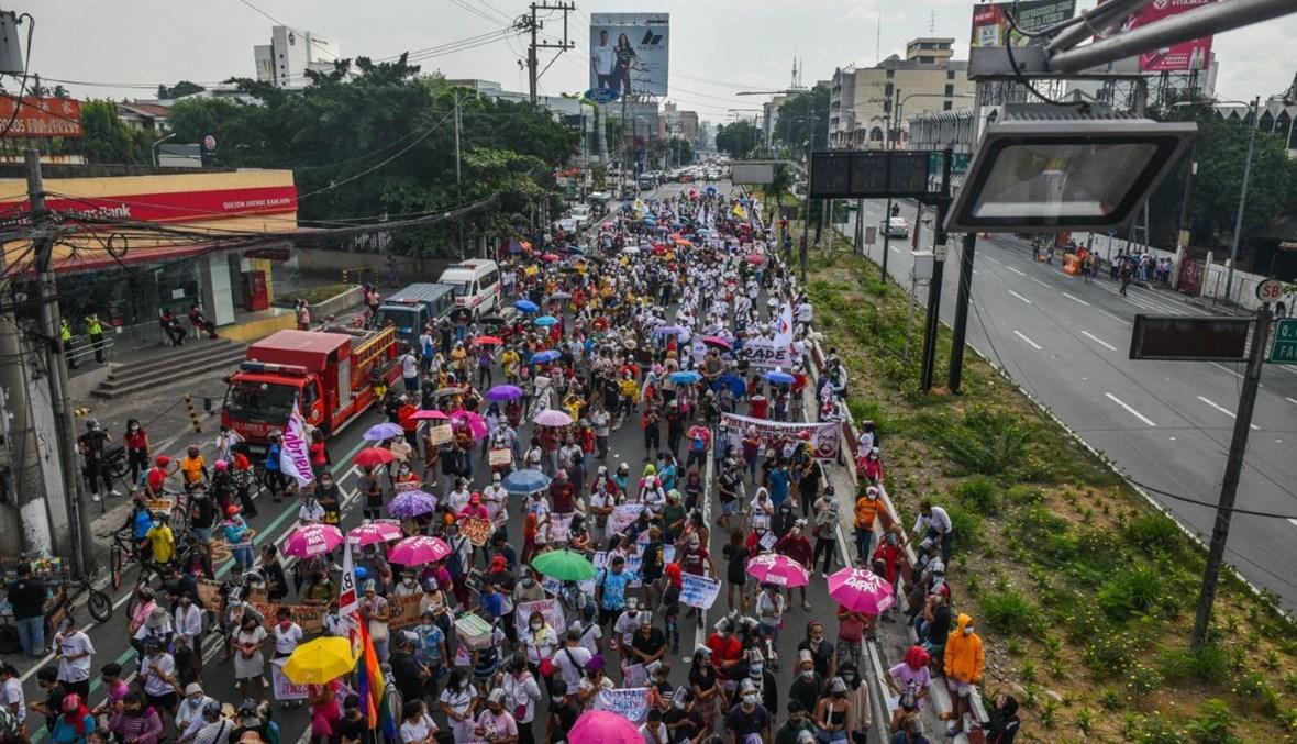 خلال تظاهرة في مانيلا، في عيد العمال (1 ايار 2021، أ ف ب).