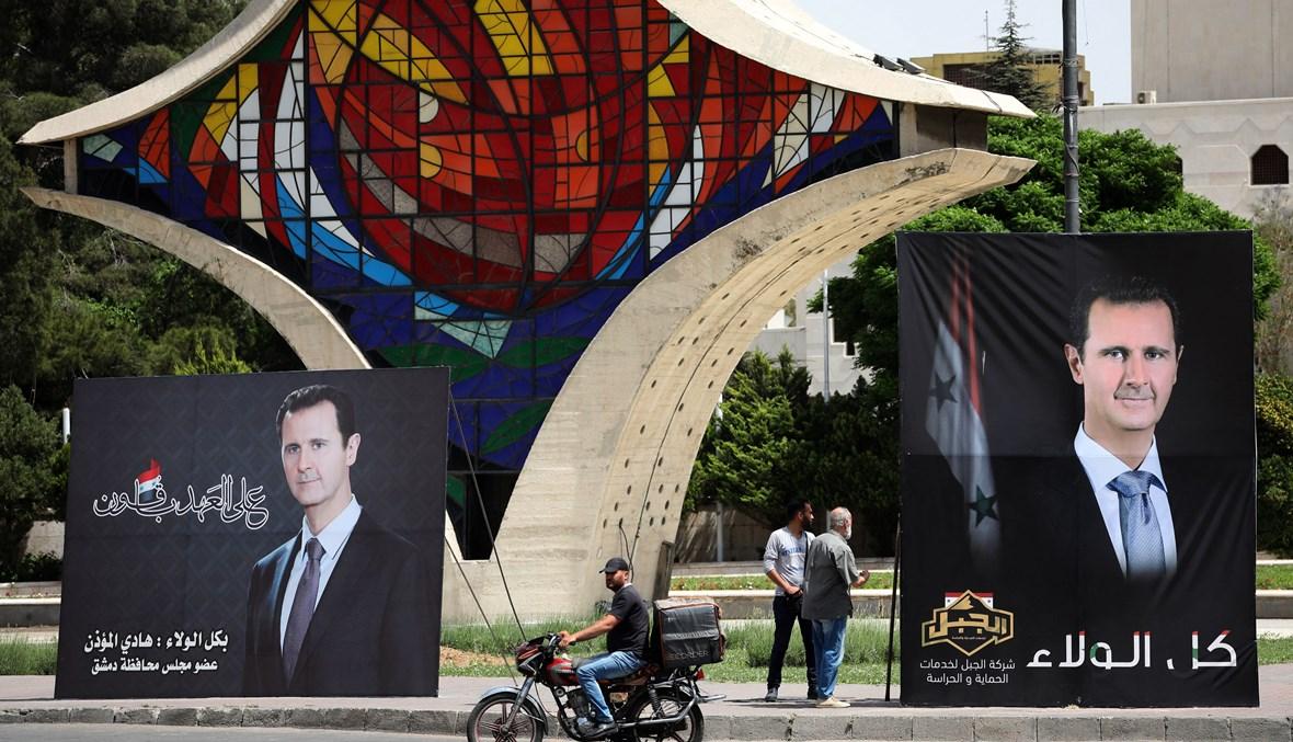 صور للأسد في دمشق (أ ف ب).