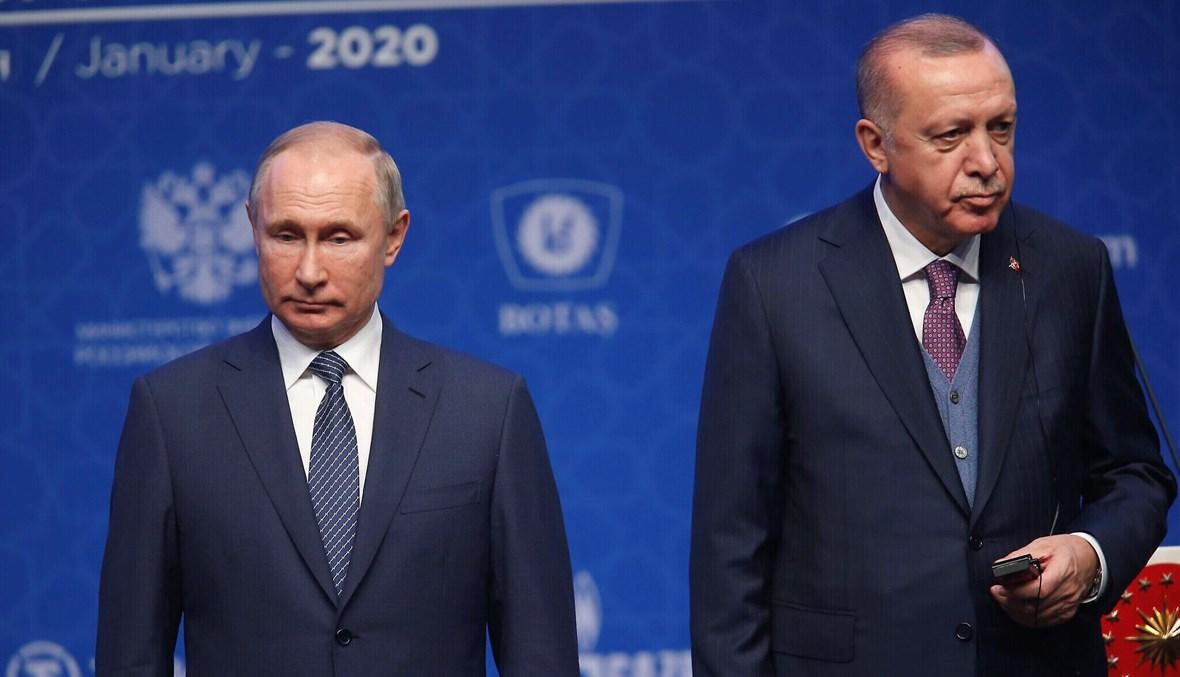 """الرئيسان التركي رجب طيب إردوغان والروسي فلاديمير بوتين خلال حفل افتتاح خط أنابيب تورك ستريم في اسطنبول، كانون الثاني 2020 - """"أ ب"""""""