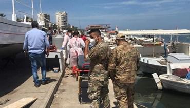 انتشال الجثة بحضور الصليب الأحمر والقوى الأمنية.