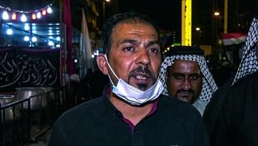 لقطة شاشة من فيديو يظهر فيها الناشط العراقي إيهاب الوزني خلال إحياء ذكرى الإمام الحسين في مدينة كربلاء (27 آب 2020، أ ف ب).