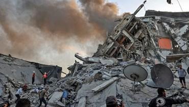برج الشروق غرب مدينة غزة بعد تدميره (أ ف ب).