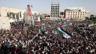 من العراق وتونس إلى اليونان وألمانيا... تضامن مع القضية الفلسطينية (أ ف ب).