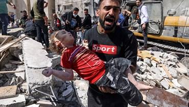 الوحشية الإسرائيلية على أطفال غزّة (أ ف ب).