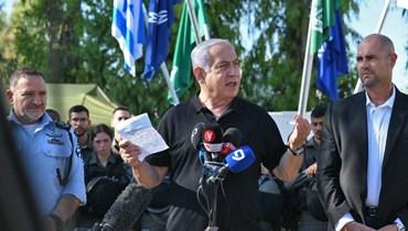 نتنياهو يتكلم خلال لقاء مع شرطة الحدود الإسرائيلية في وسط مدينة اللد بالقرب من تل أبيب (13 ايار 2021، ا ف ب).