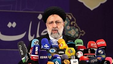 رئيس السلطة القضائية الايرانية ابرهيم رئيسي يتحدث بعد تقديم ترشيحه للاننتخابات الرئاسية في طهران السبت.(أ ف ب)