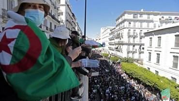 خلال تظاهرة في الجزائر العاصمة (12 آذار 2021، أ ب).