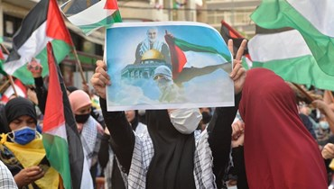 تحرك داعم لفلسطين في الضاحية الجنوبية (نبيل اسماعيل).