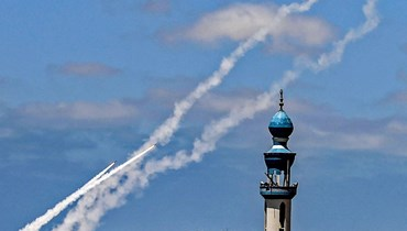 إطلاق صواريخ من رفح في جنوب قطاع غزة باتجاه إسرائيل (20 ايار 2021، أ ف ب).