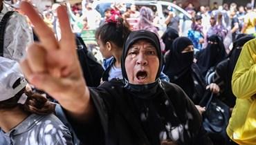 أنصار لحركة حماس يحتفلون بعد وقف إطلاق النار، في خان يونس جنوب قطاع غزة (21 ايار 2021، أ ف ب).