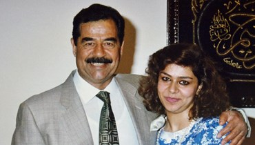 الرئيس العراقي الأسبق صدام حسين وابنته رغد (أ ف ب).