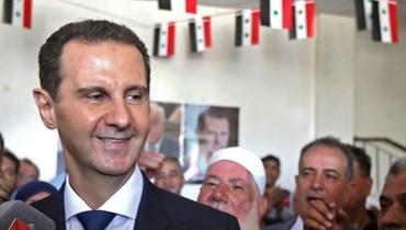 صورة من مشاركة الاسد في الاقتراع