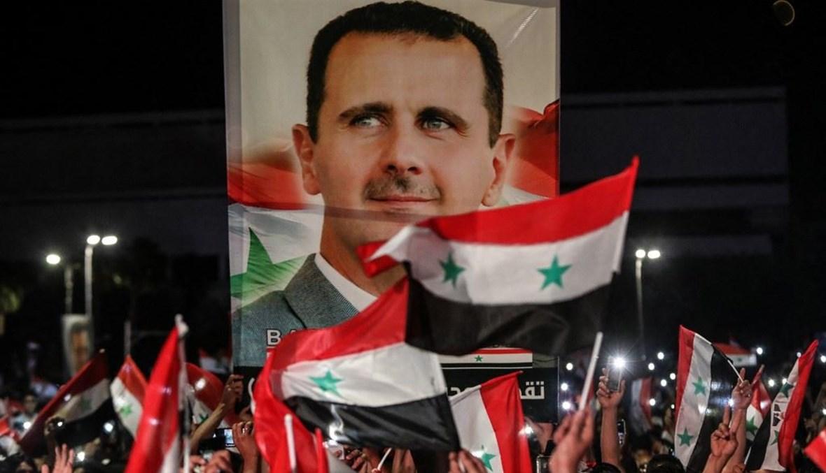 احتفالات بفوز الأسد في سوريا (أ ف ب).