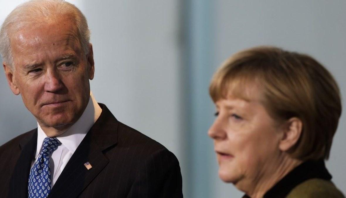 """بايدن يلتقي بالمستشارة الألمانية أنجيلا ميركل حين كان نائباً للرئيس الأميركي باراك أوباما - """"أ ب"""""""