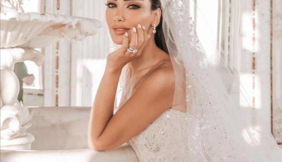 إطلالة ملكية بالأبيض لجسيكا عازار في زفافها