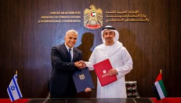 وزيرا خارجية الإمارات وإسرائيل (ا ف ب)