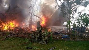 حطام الطائرة العسكرية الفيليبينية (أ ف ب)