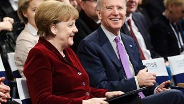 نائب الرئيس الاميركي حينها جو بايدن والمستشارة الألمانية أنجيلا ميركل في مؤتمر ميونخ للأمن، 2015 - كلاينشميدت/أم أس سي