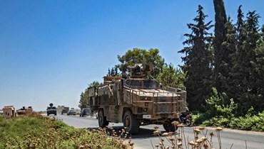 دورية تركية- روسية مشتركة في ريف بلدة الدرباسية بمحافظة الحسكة شمال شرق سوريا (14 تموز 2021ـ أ ف ب).