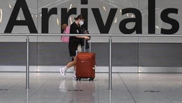"""سيدة في المطار (تعبيرية- """"أ ف ب)."""