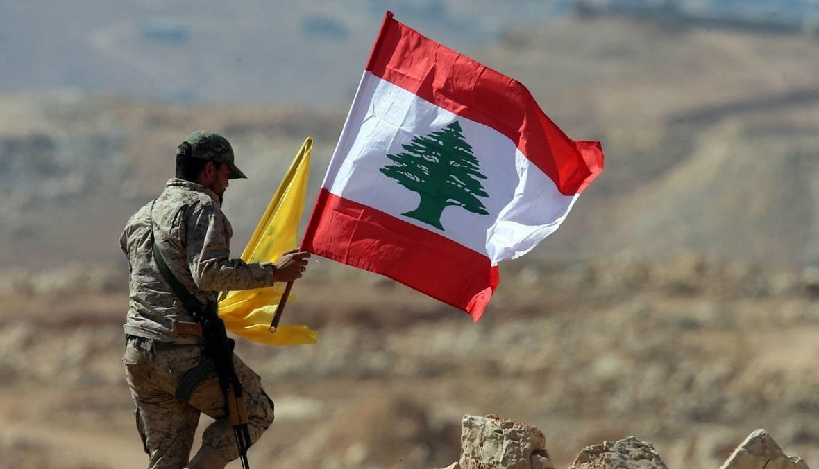 """مقاتل من """"حزب الله"""" عند الحدود اللبنانية الجنوبية (أ ف ب)."""