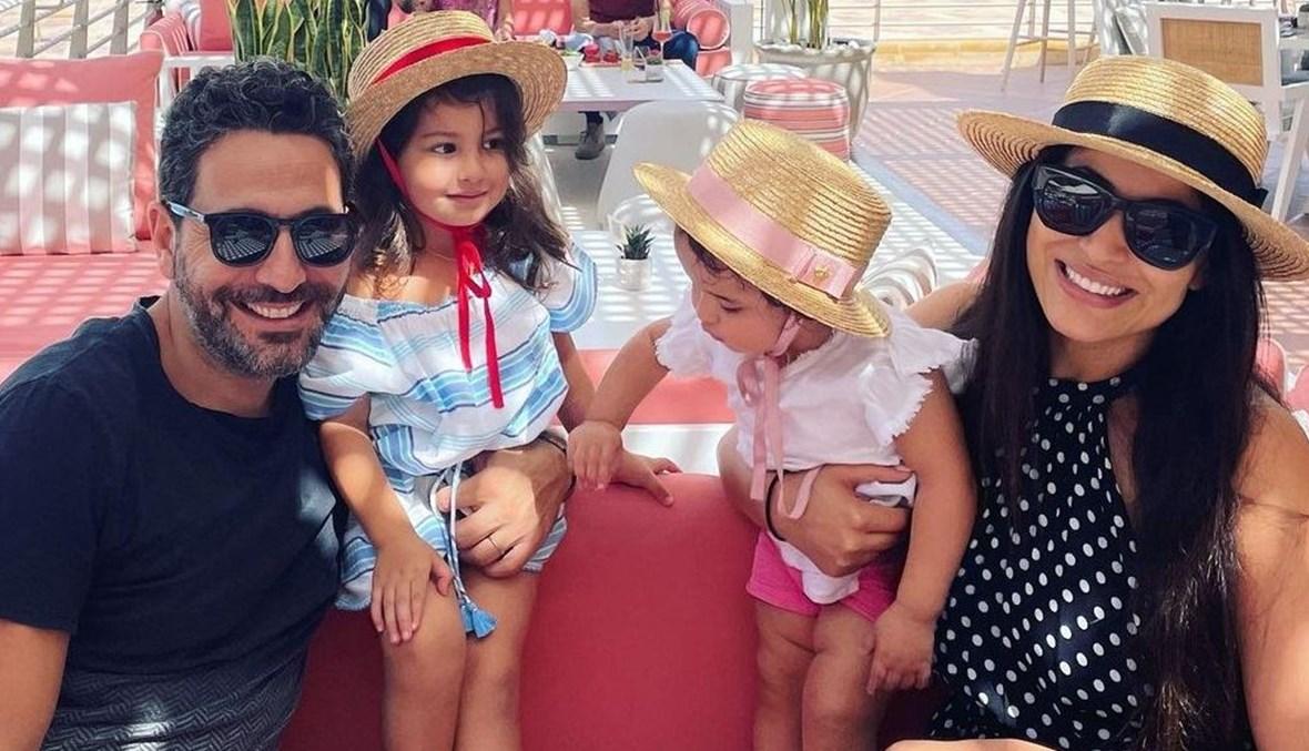 وسام بريدي وريم السعيدي وابنتيهما.