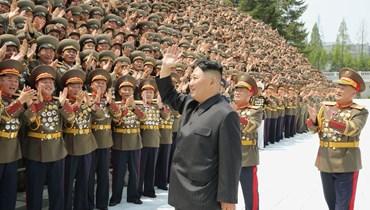 كيم مشاركا في ورشة العمل الأولى لقادة الجيش الشعبي الكوري والمسؤولين السياسيين في بيونغ يانغ (27 تموز 2021، أ ف ب).