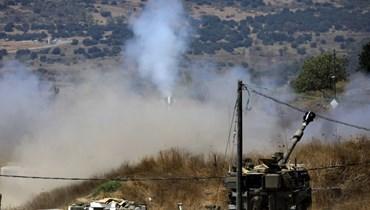ألمدفعية الإسرائيلية تقصف مواقع لبنانية (أ ف ب).