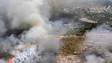 مكان سقوط صوايخ اسرائيلية في جنوب لبنان  (ا ف ب)
