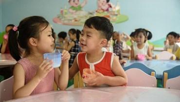 طفلان في كوريا الجنوبية (أ ف ب).