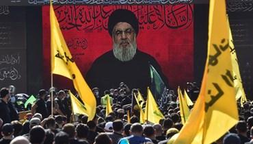 """مناصرو """"حزب الله"""" يتابعون خطاب عاشوراء للأمين العام للحزب السيّد حسن نصرالله في الضاحية الجنوبية لبيروت (تصوير حسام شبارو)."""