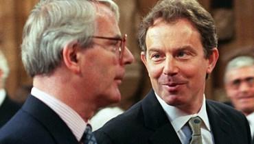 توني بلير وجون ميجور في البرلمان (أ ف ب).