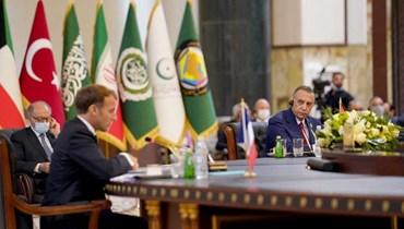 مؤتمر إقليمي في بغداد بحضور ماكرون (أ ف ب).