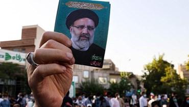 خلال الحملة الانتخابية دعماً للرئيس الإيراني ابراهيم رئيسي (أ ف ب).