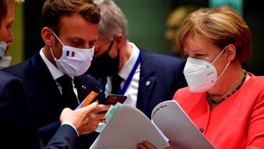 """المستشارة الألمانية أنجيلا ميركل والرئيس الفرنسي إيمانويل ماكرون - """"أ ب"""""""