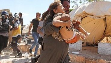 المأساة السورية (أ ف ب).