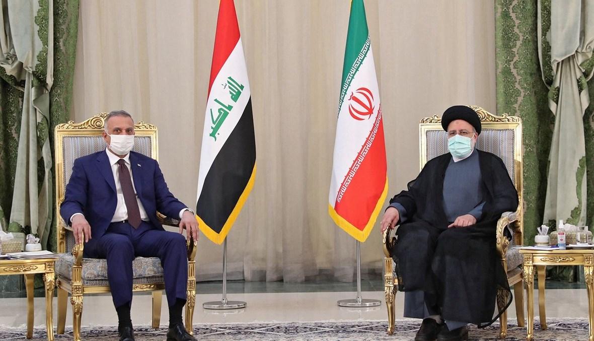 رئيس الوزراء العراقي مصطفى الكاظمي والرئيس إبراهيم رئيسي (أ ف ب).