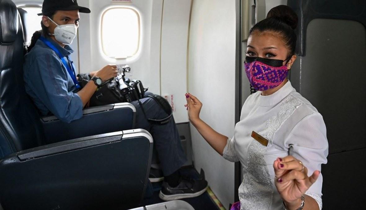 """من داخل الطيران الماليزي (تعبيرية- """"أ ف ب"""")."""
