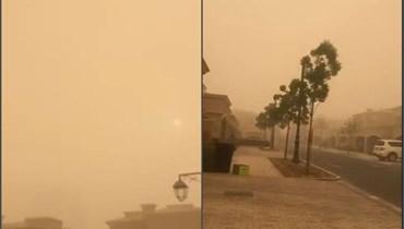 لقطتا شاشة من فيديو للعاصمة الرملية في دبي (موقع طقس العرب).