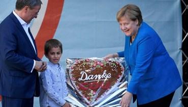 """""""لإبقاء ألمانيا مستقرّة"""".... ميركل تحشد الدعم لمرشّح حزبها عشية الانتخابات"""