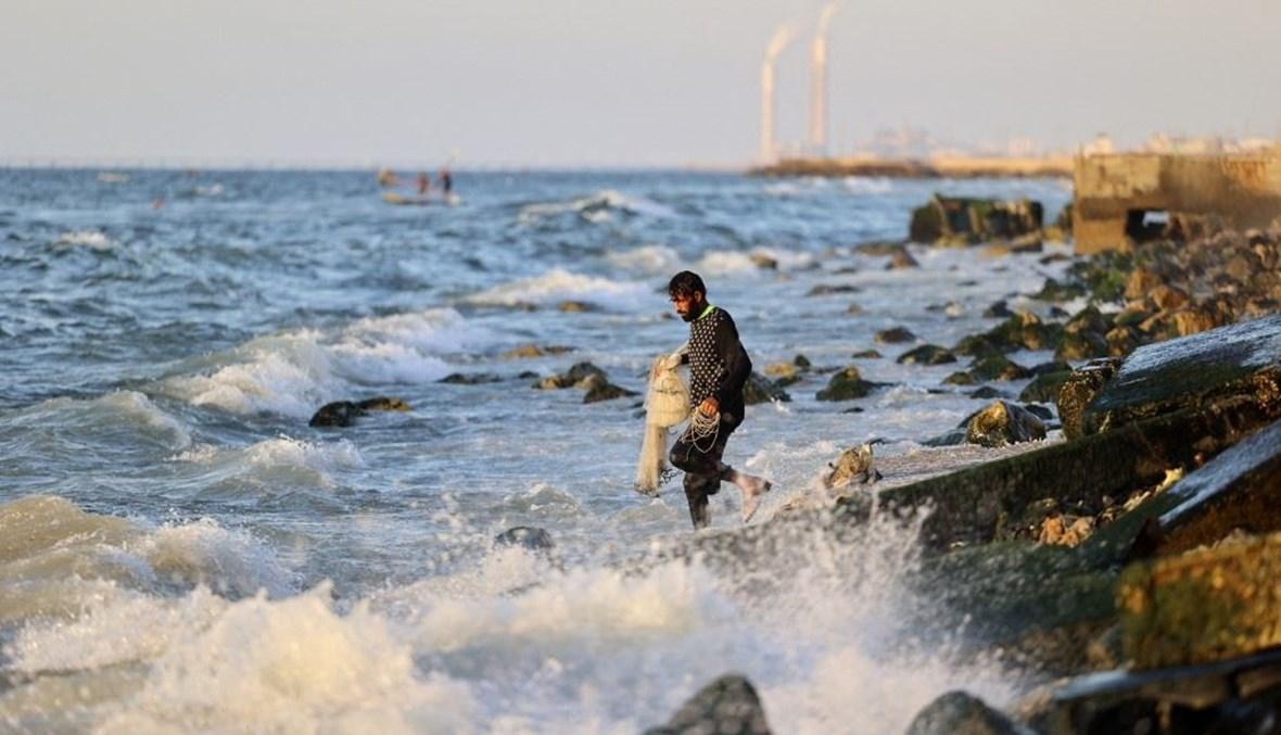 """شاطئ غزة (تعبيرية- """"أ ف ب"""")."""