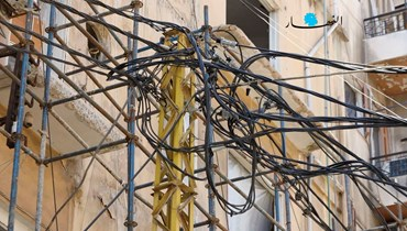 """إمدادات كهربائية (تعبيرية- """"النهار"""")."""