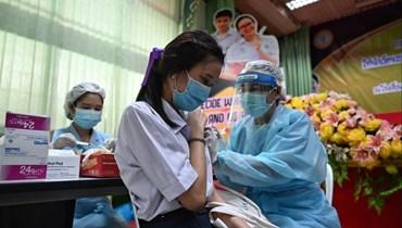 حملة التلقيح في تايلاند (أ ف ب).