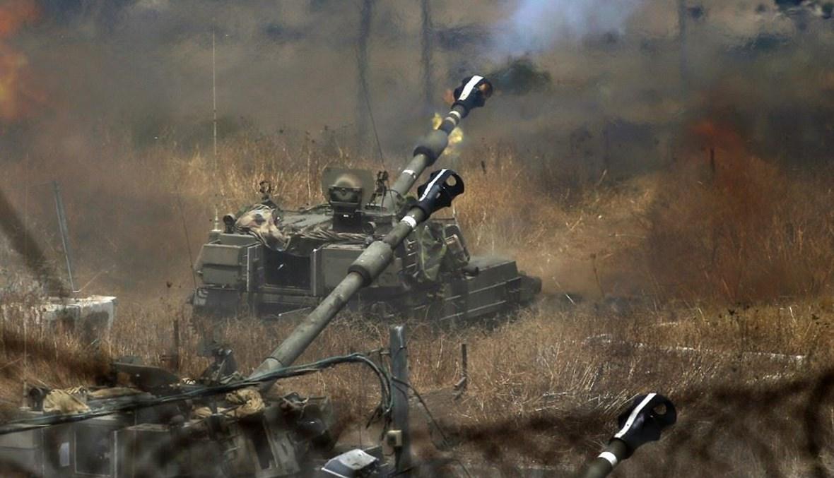 """الدبابات الإسرائيلية تقصف أحراجاً في جنوب لبنان عقب إطلاق """"حزب الله"""" صلية صواريخ نحو مزارع شبعا المحتلّة (أرشيف """"أ ف ب"""")."""